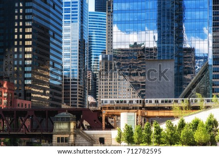 City of Chicago skyscrapers with elevated train.