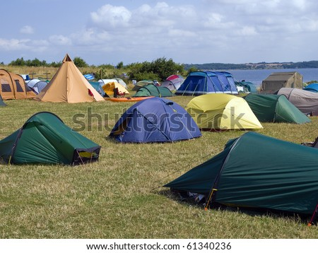 City of colorful tents in a sea beach camping site village
