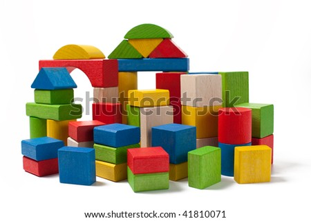 city of colorful wooden toy blocks isolated on white background
