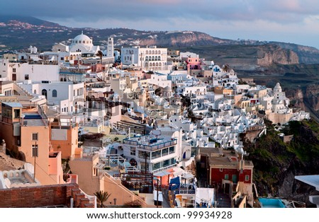 City of Fira and the caldera at Santorini island in Greece during the sunset - stock photo