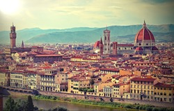city of Florence in the Tuscany region in Italy and the dome of the Cathedral with old toned effect