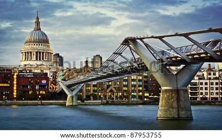 City of London, Millennium bridge and St. Paul's cathedral at twilight - stock photo