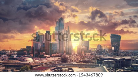 City of London skyscrapers and sunset. Beautiful dramatic sky, London, UK