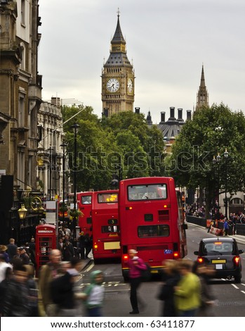 City of  London, View from Trafalgar Square: Big Ben, double deckers, red phone box, taxi cab, people.