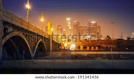 City of Los Angeles at night. Scenic view of downtown skyline with bridge in foreground. #191341436