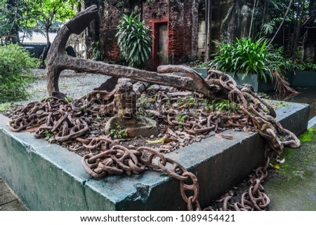 City of Manila, Philippines, October 4, 2014: a rusty anchor and chain on display at a historic park #1089454421