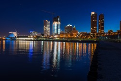 City of Milwaukee Wisconsin at Night lakefront lights reflection in lake Michigan
