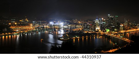 City of Pittsburgh at night with stadium lights on