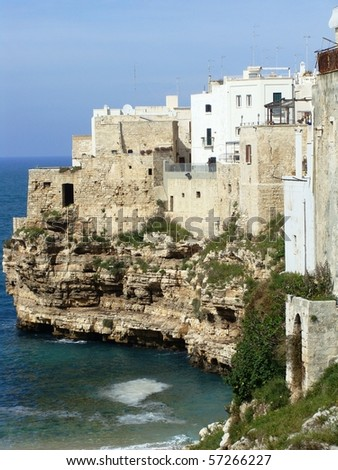 City of Polignano A Mare in southern Italy built on cliffs and sea caves. - stock photo