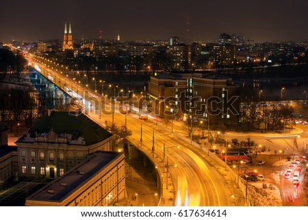 City of Warsaw at night in Poland, Aleja Solidarnosci street (Solidarity Avenue), Praga district on the horizon. #617634614