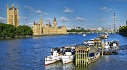 City of Westminster is one of the most visited place in UK.  This view includes: Big Ben, Houses of Parliament, and London Eye.