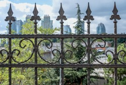 City on the background of iron. Railings prison iron background city and sky idea. Selective focus