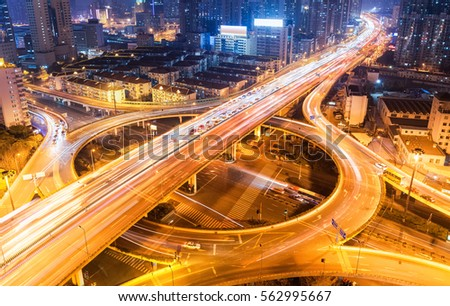 city overpass at night, circular flyover and traffic light intersection in shanghai