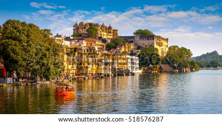 City Palace and Pichola lake in Udaipur, Rajasthan, India, Asia #518576287