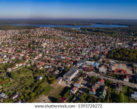 City panorama with houses and lakes - drone photo from Poland #1393728272
