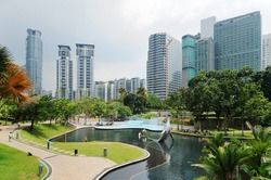 City park with modern buildings in Downtown of Kuala Lumpur