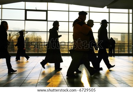 City people walking in a futuristic tunnel - stock photo