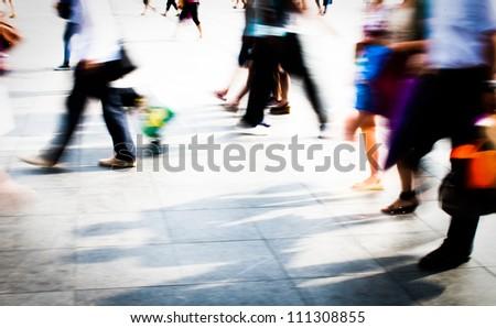 city people walking on piazza in motion blur