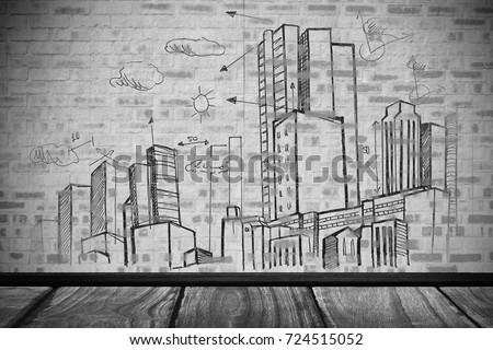 City plan against close-up of gray brick wall