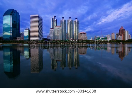 City reflection from Benjakitti garden of Thailand