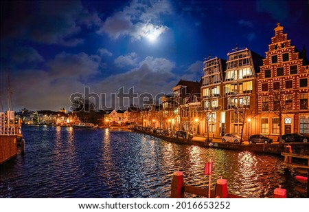 City river in the late evening. Evening city river. City river at late evening ストックフォト ©