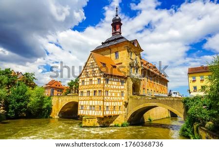 City river island castle landmark. Castle river bridge in Germany. River castle bridge view