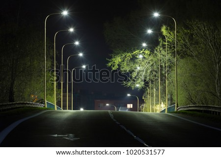 city road at night with LED streetlights, central view