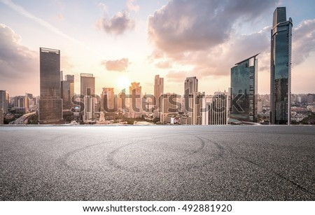 city road with cityscape and skyline of shanghai CBD