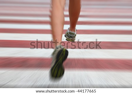 City Running. Closeup of woman running shoes in action on crosswalk in urban setting. Zoom blurred effect with shallow depth of field with focus on right running shoe.