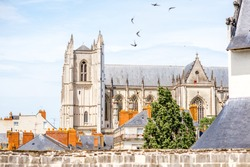City scape view on the beautiful saint Pierre cathedral with birds flying in Nantes city in France