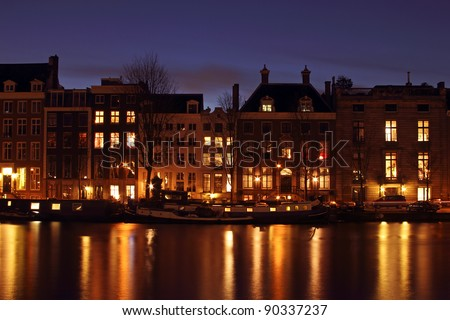 City scenic and house boats in Amsterdam the Netherlands
