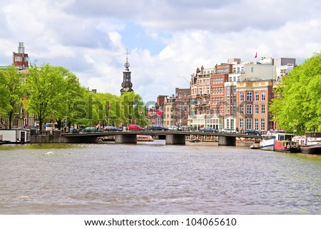 City scenic from Amsterdam with the Munt tower in the Netherlands - stock photo