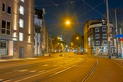City scenic in an empty Amsterdam  during the corona crisis in the Netherlands by night