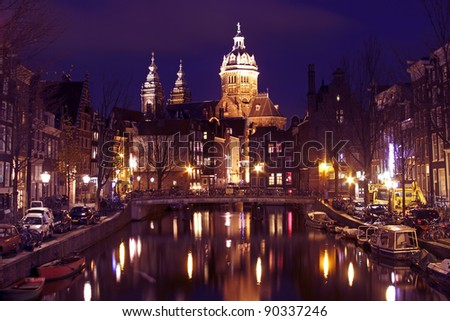City scenic with the St. Niclaas church  in Amsterdam in the Netherlands