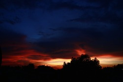City skyline, silhouettes of against dramatic sky in sunset, dawn, late evening hours