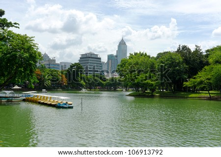 City skyline with view of city park lake
