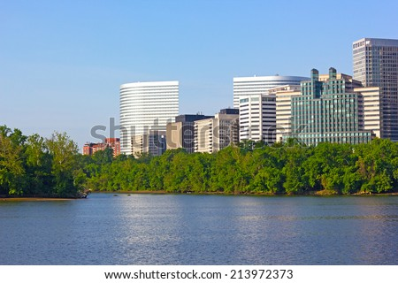 City skyscrapers on Virginia side of Potomac River. View on office buildings from Georgetown Park, Washington DC.