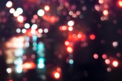 city street bokeh night light blurred background with abstract beautiful glitter colors glow in the dark, photo idea for creative design background product presentation concept with copy space