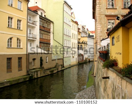 City street, water and buildings.  Prague