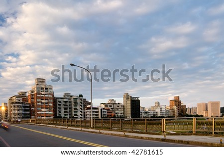 City street with apartments and dramatic clouds in sky in Taipei, Taiwan. - stock photo