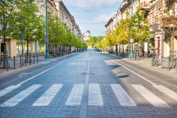 City street with empty crossroad,  road and morning light in Europe, Lithuania, Vilnius