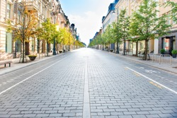 City street with empty road and morning light in Europe, Lithuania, Vilnius