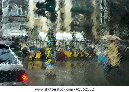 City through wet glass. The photo is made through wet glass of the car. The file is executed without photofilters.