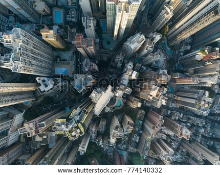 City Top View of Skyscrapers Building by drone Hong Kong - Aerial view cityscape flying above Hong Kong City development buildings, energy power infrastructure Financial and business center Asia #774140332