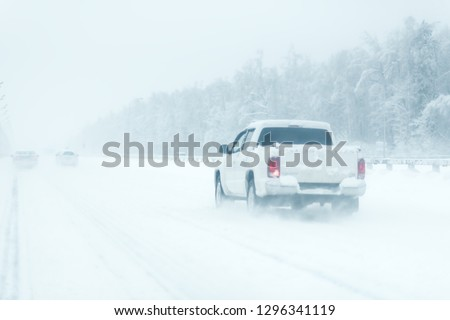 city traffic car road winter snow. road with a sound barrier. white pickup stock photo