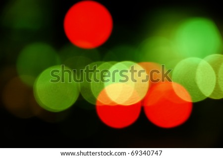 City traffic lights at night. Abstract blurry circles background.