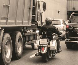 city traffic with lone biker