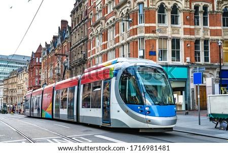 City tram on a street of Birmingham in England