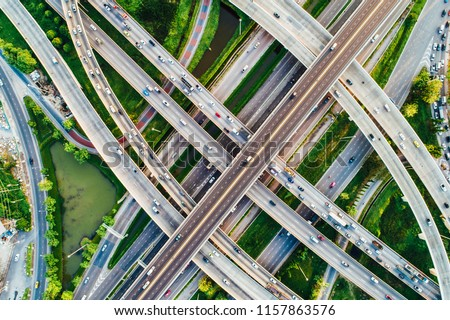 City transport X sign junction road aerial view with car movement, Transport industry