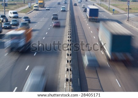 city urban scene heavy loaded highway street with blurred cars speed motion